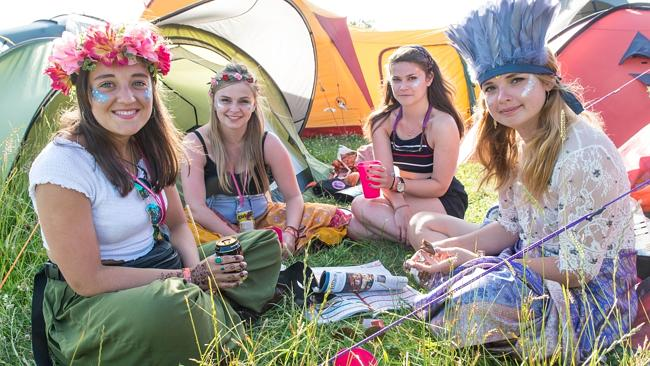 Party time ... Festival goers enjoy the sunshine outside their tents on Day 1 of the Glas