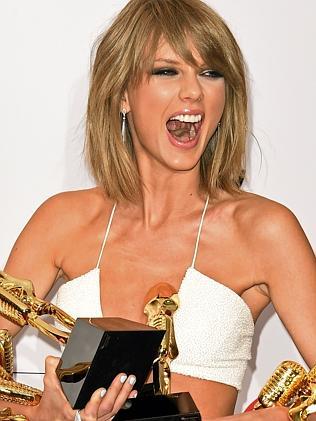 Taylor Swift has so many awards she can hardly carry them all.