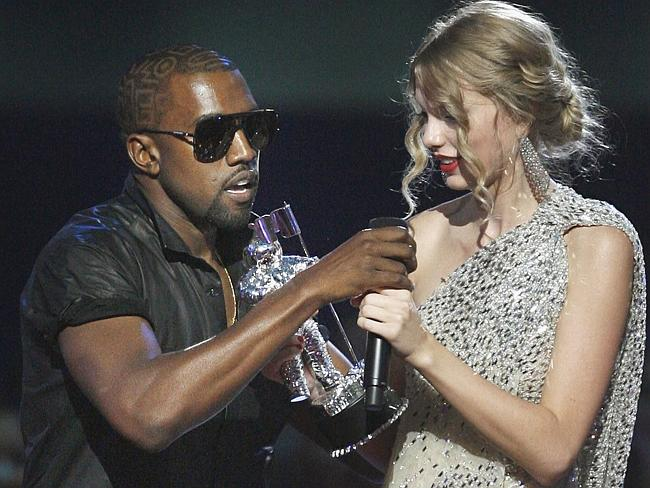 "Kanye West takes the microphone from singer Taylor Swift as she accepts the ""Best Female"