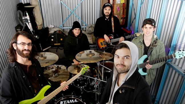 Northlane practice in a Penrith warehouse after making too much noise at Jon's farm.