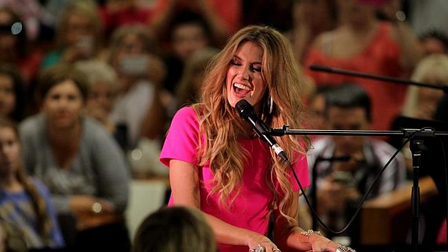 Singer and judge on 'The Voice' TV show, Delta Goodrem sings her new single to fans at th